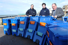 Councillor John Wynn Jones with staff from the Council's waste and recycling team as they recently roll-out the 'Cartgylchu' stackable recycling box in Tywyn