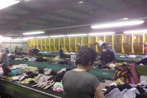 Garments are sorted manually up to seven times